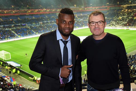 25. Henri Bedimo (OL) et Stéphane Le Coz (Tui France)